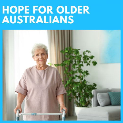 ageing female walking with frame at home after help from physiotherapist